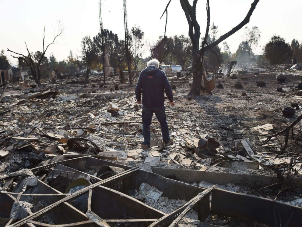 PHOTO: Homeowner Phil Rush looks at the remains of his home destroyed by wildfire in Santa Rosa, Calif., Oct. 11, 2017.