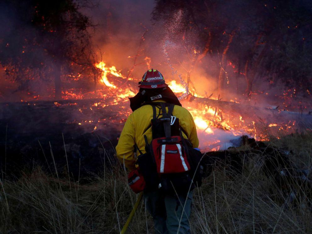 PHOTO: Firefighters battle a wildfire near Santa Rosa, Calif., Oct. 14, 2017.