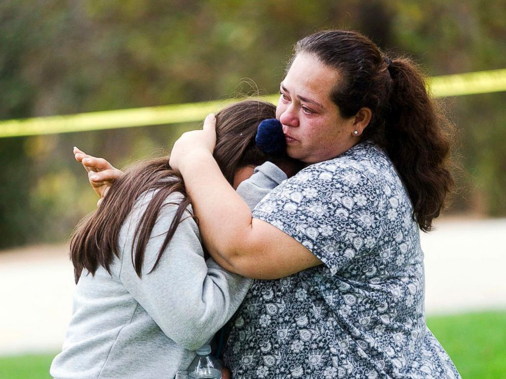 PHOTO: Maria Ortiz consoles her 5th-grade daughter, Crystal Godinez, after she was released from evacuation at Castle View Elementary School in Riverside, Calif., Oct. 31, 2017.