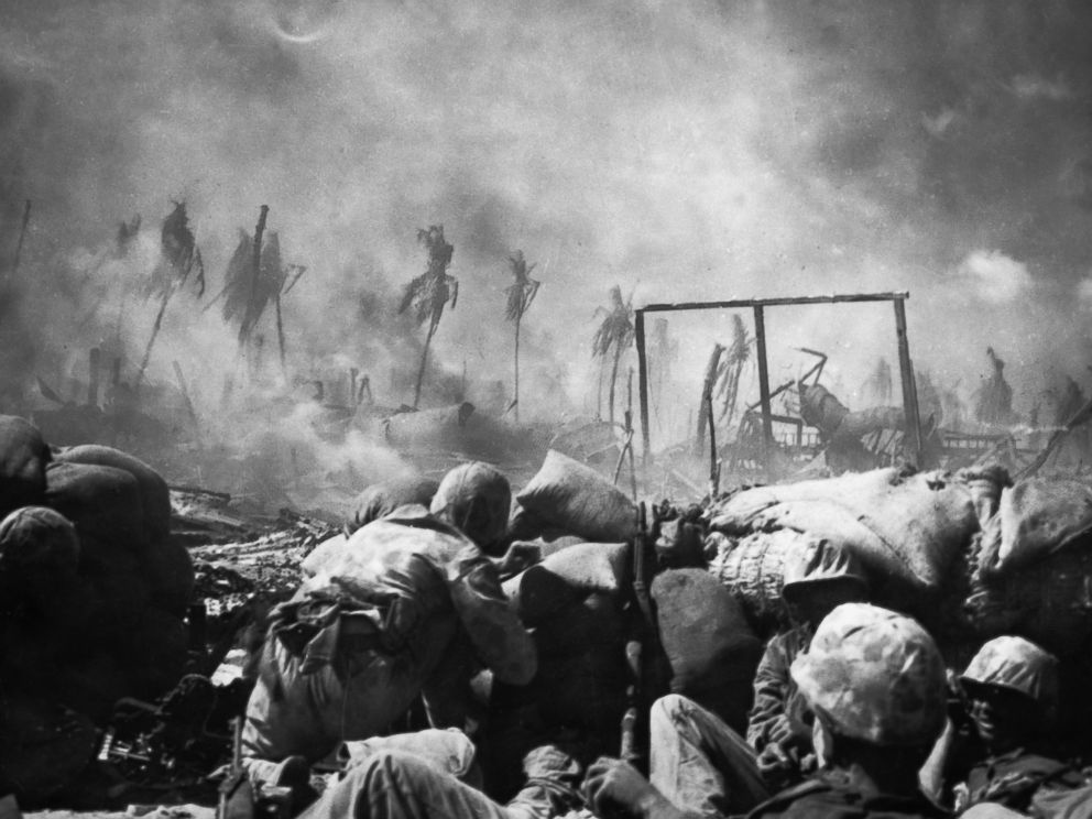 PHOTO: U.S. Marines are seen firing from behind a sand bag entrenchment on the island of Tarawa where the highest point of land was only twelve feet high, 1943.