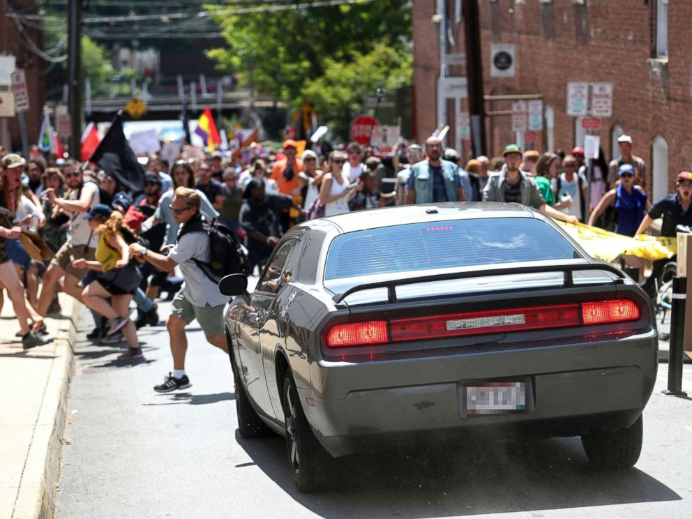 PHOTO: A vehicle drives into a group of protesters demonstrating against a white nationalist rally in Charlottesville, Va., Aug. 12, 2017.