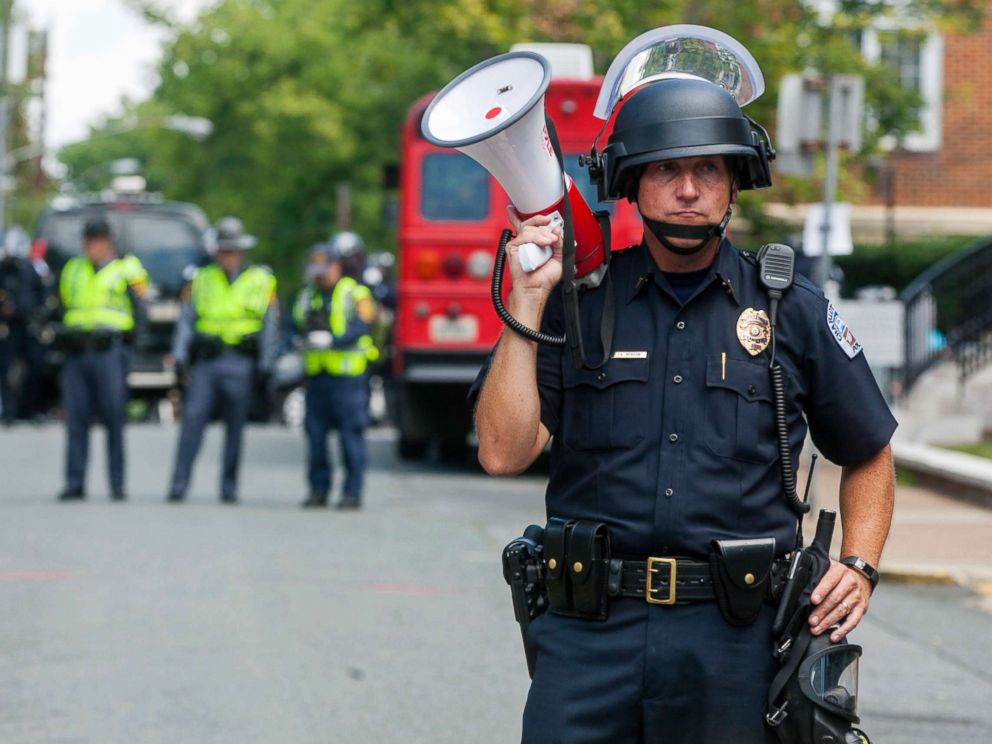 PHOTO: A police officer stands in the middle of the street after declaring the protest an unlawful assembly during a white nationalist rally, Aug. 12, 2017, in Charlottesville, Va.