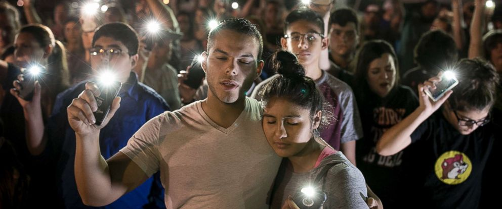 PHOTO: Matthew Mata and Erika Gonzalez participate in a memorial service for the victims of Sundays church shooting in Sutherland Springs, Texas, Nov. 6, 2017.