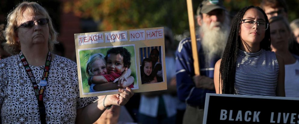 PHOTO: People stand together for an interfaith vigil at Broad Street Park in Claremont, N.H., Sep. 12, 2017.