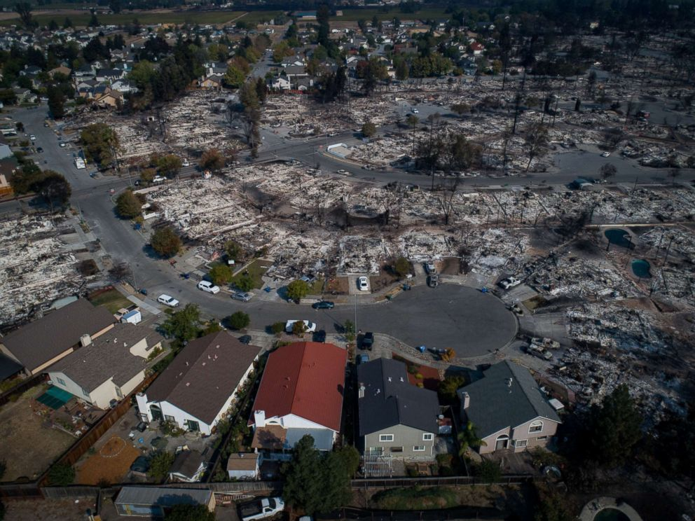 PHOTO: An aerial photograph shows a handful of homes that escaped destruction by wildfire in the Coffey Park neighborhood of Santa Rosa, Calif., Oct. 11, 2017.