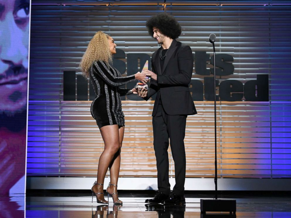 PHOTO: Colin Kaepernick receives the SI Muhammad Ali Legacy Award from Beyonce during Sports Illustrated Sportsperson of the Year Show on Dec., 5, 2017, in New York City.