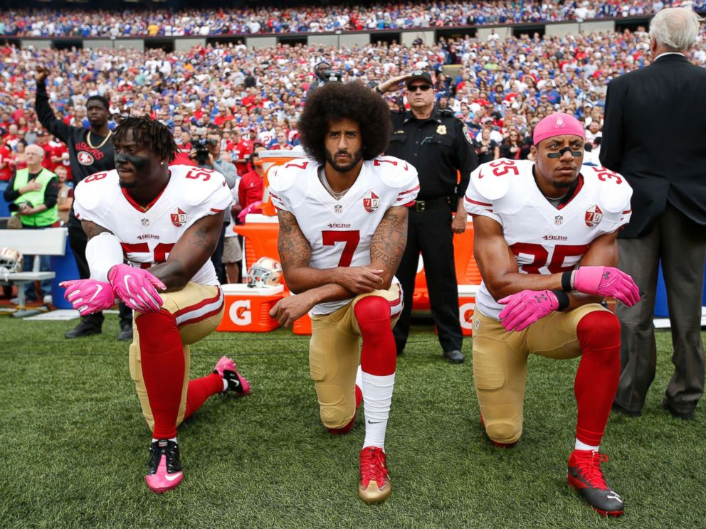 PHOTO: Eli Harold #58, Colin Kaepernick #7, center, and Eric Reid #35 of the San Francisco 49ers kneel in protest on the sideline, during the anthem, prior to the game against the Buffalo Bills at New Era Field, Oct. 16, 2016, in Orchard Park, New York.