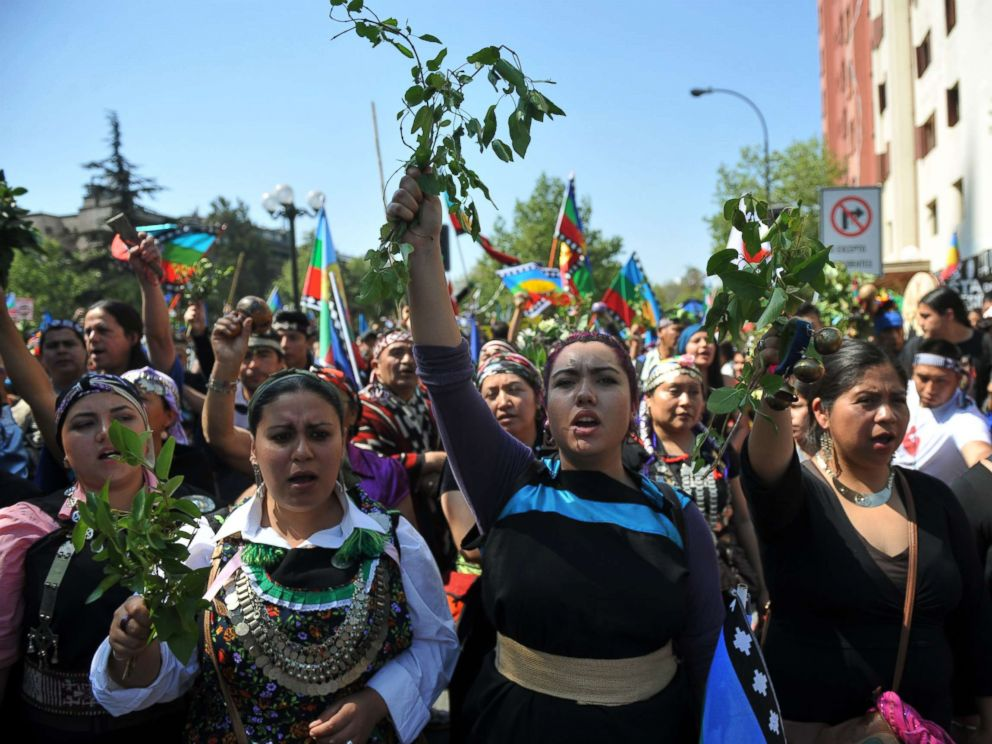 PHOTO: Mapuche indigenous people march in protest in downtown Santiago, on Oct. 12, 2013, during the commemorations for Columbus Day.