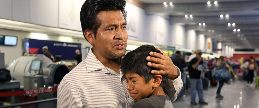 PHOTO: A tearful Jesus Lara Lopez, 37, of Willard, Ohio, says goodbye to one of his sons, before he is deported back to Mexico, July 18, at Cleveland Hopkins International Airport.
