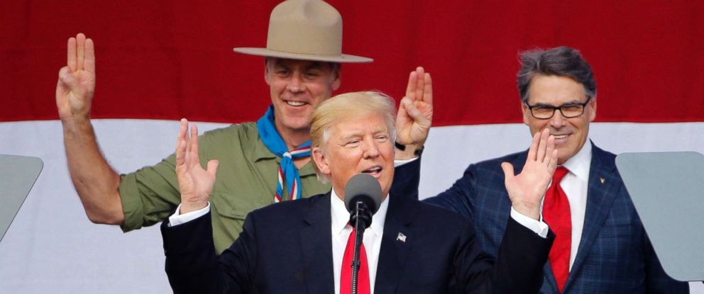 PHOTO: President Donald Trump gestures as former boys scouts, Interior Secretary Ryan Zinke, left, Energy Secretary Rick Perry, watch at the 2017 National Boy Scout Jamboree at the Summit in Glen Jean, W. Va., July 24, 2017.