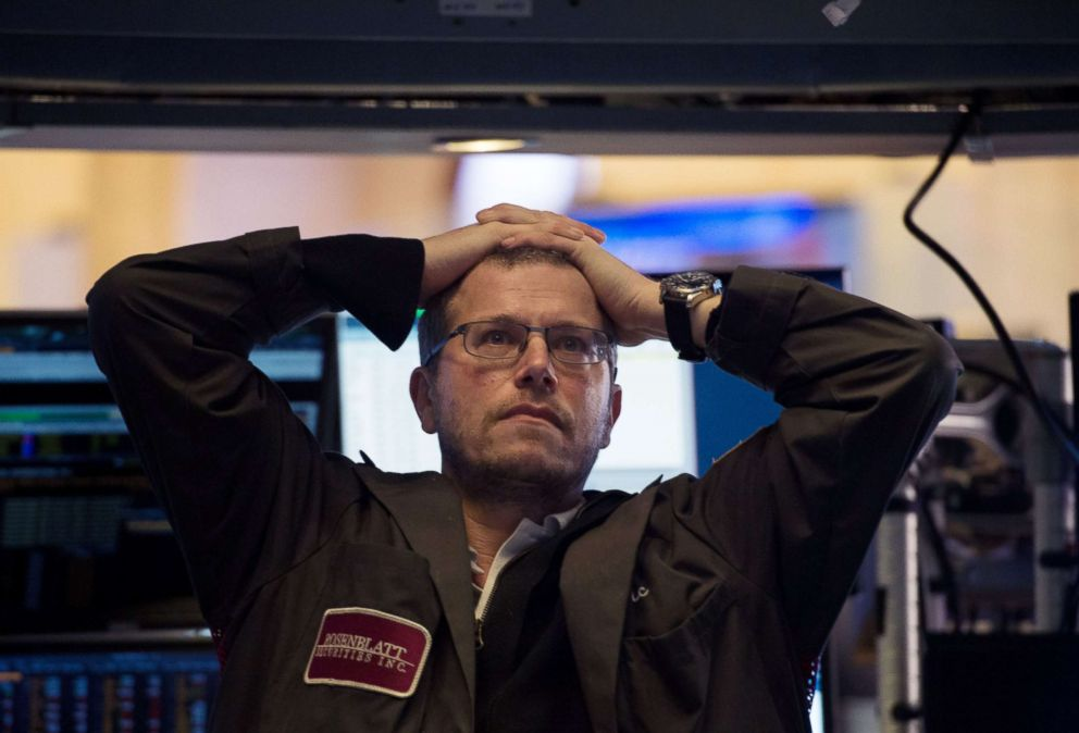 PHOTO: A trader works on the floor at the closing bell of the Dow Industrial Average at the New York Stock Exchange, Feb. 5, 2018 in New York.