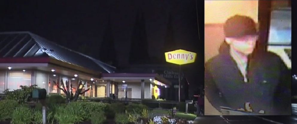 A surveillance photo is show of the suspect in Oregon who doused a man with gasoline and lit him on fire at a Dennys restaurant.