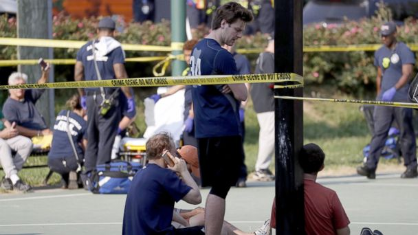 PHOTO: People gather near the scene of a shooting at the Republican Congressional baseball team  practice in Alexandria, Va, June 14, 2017.