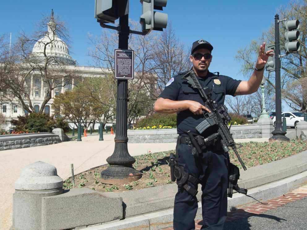 PHOTO: Capitol Police direct pedestrians away in response to a report of shots fired around the U.S. Capitol in Washington D.C., March 28, 2016.