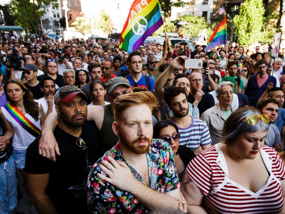 PHOTO: People gather for a vigil outside the Stonewall Inn in New York for the victims of a mass shooting at an Orlando, Florida gay club, June 12, 2016.