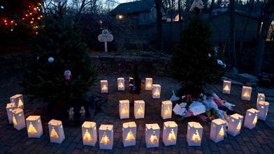 http://a.abcnews.com/images/US/epa_vigil_lanterns_jef_121215_wb.jpg