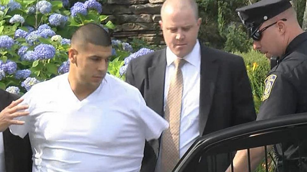 PHOTO: Aaron Hernandez escorted from home by police