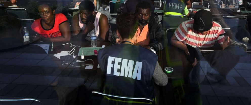 PHOTO: Evacuees seeking financial help consult with FEMA agents at the Convention Center which is serving as an evacuation shelter after Hurricane Harvey caused heavy flooding in Houston, Aug. 30, 2017.