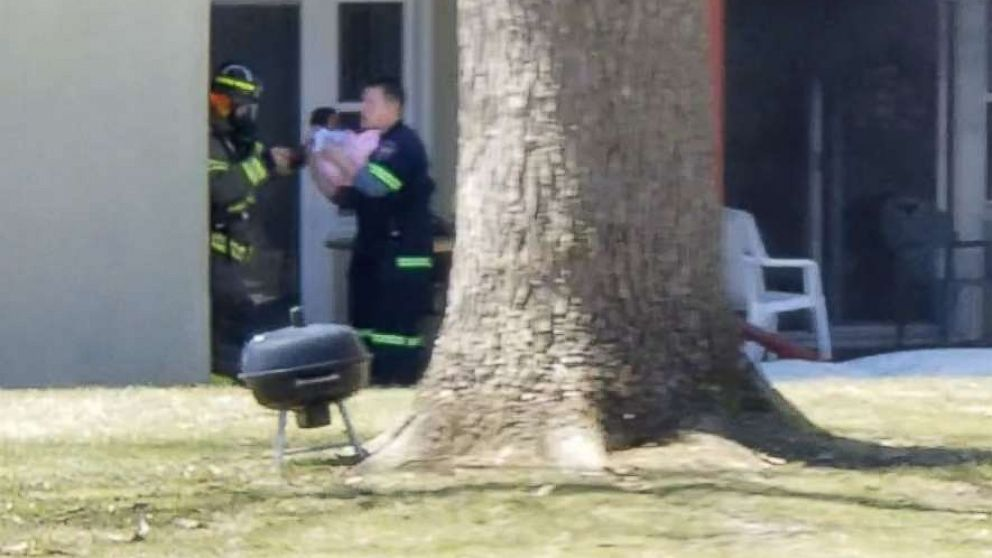 Assistant fire chief catches baby tossed from balcony in apartment fire
