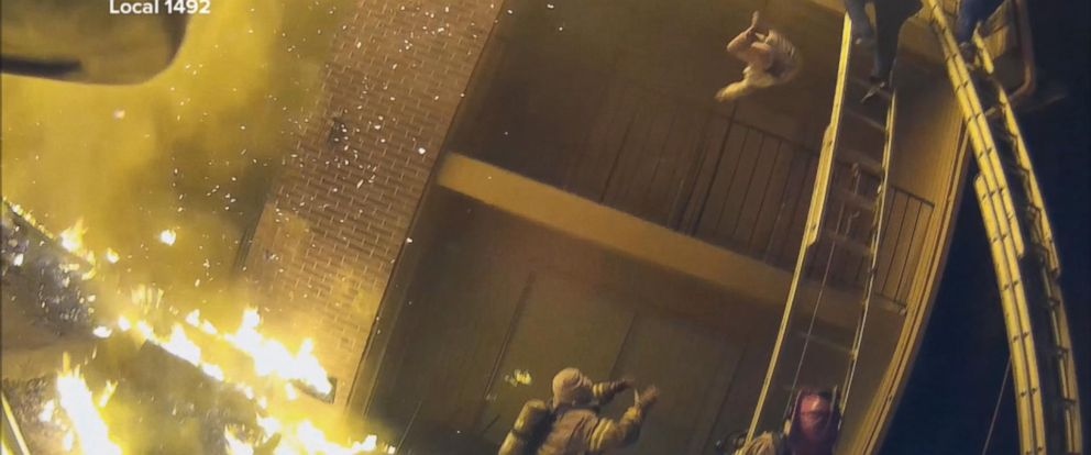 Image result for Video: Fireman Catches Child Thrown From 3rd Floor Balcony