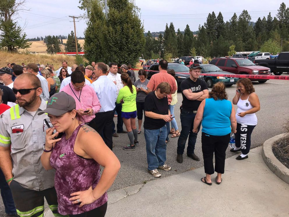 PHOTO: Parents gather in the parking lot behind Freeman High School in Rockford, Wash. to wait for their children, after a deadly shooting at the school on Sept. 13, 2017.