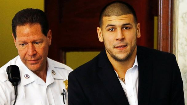 PHOTO: Aaron Hernandez is escorted into the courtroom of the Attleboro District Court for his hearing on Aug. 22, 2013 in North Attleboro, Mass.