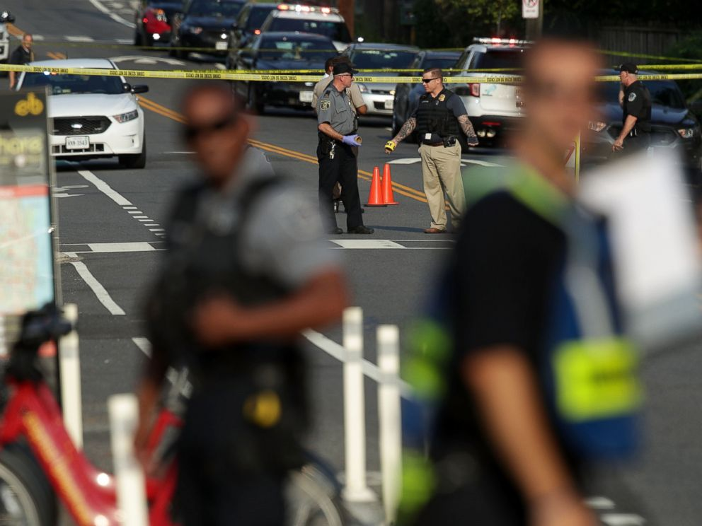 PHOTO: Investigators gather near the scene where fires were shot near where congressmen were gathered, June 14, 2017 in Alexandria, Va.