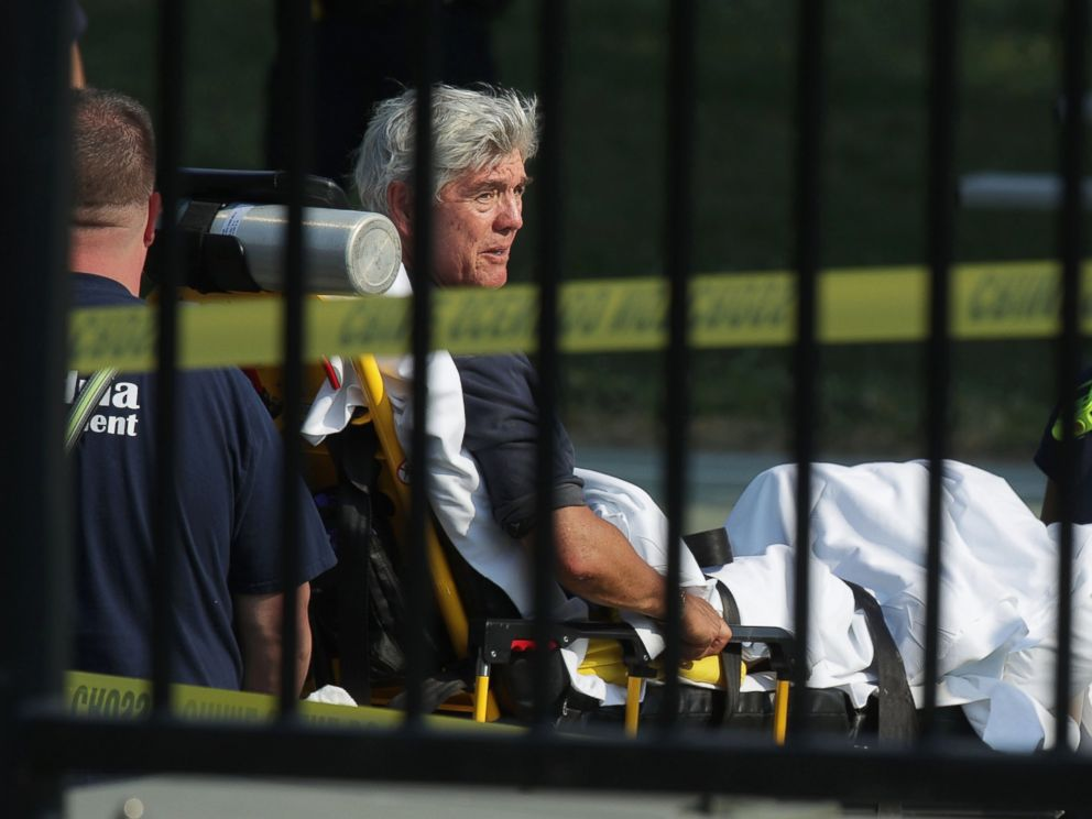 PHOTO: Rep. Roger Williams is wheeled away by emergency medical service personnel from the Eugene Simpson Stadium Park June 14, 2017 in Alexandria, Va., following a shooting at the park.