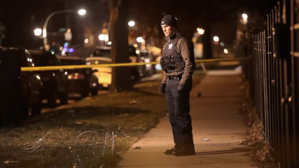 PHOTO: Police investigate the scene of a shooting where a 23-year-old woman was shot in the chest and hand and a 25-year-old man was shot in the leg on Jan. 1, 2017 in Chicago, Illinois.