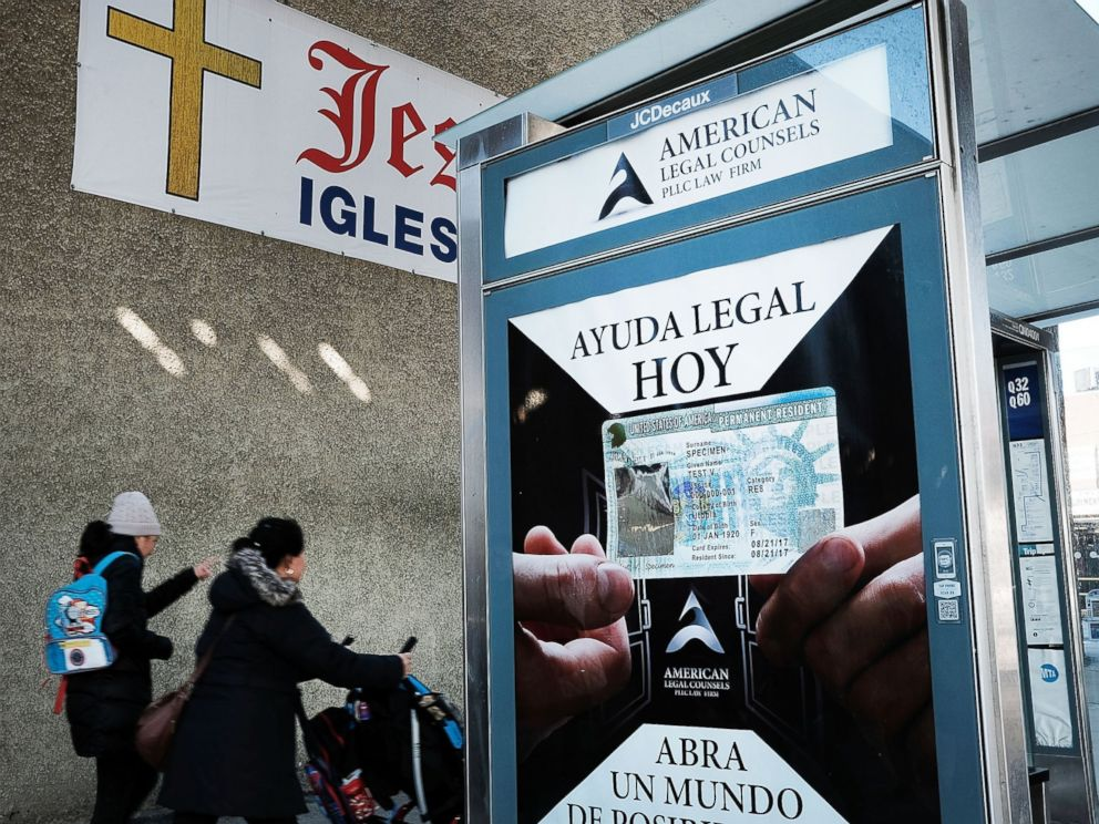 PHOTO: A sign at a bus stop advertises immigration services in a neighborhood of the Queens borough of New York City with a large Latino immigrant population on Feb. 14, 2017.