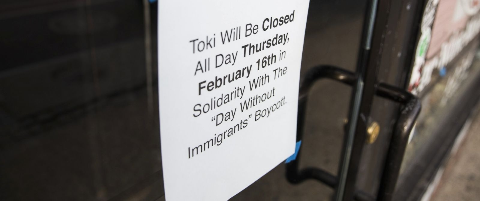 """PHOTO: A sign is tapped to the door of a restaurant announcing it will be closed in order to support its staff that are participating in the """"Day Without Immigrants"""" boycott against President Trumps immigration policies in Washington, Feb. 15, 2017."""