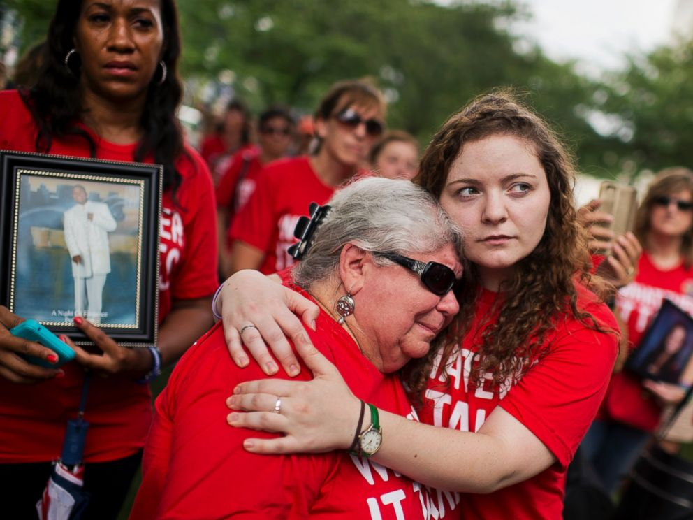 PHOTO: Ashley Cech, right, whose mother survived the Sandy Hook shootings, comforts Diane Sellgren, whose daughter committed suicide with a gun during a gun legislation rally outside the Capitol organized by Everytown for Gun Safety, Sept. 10, 2015.