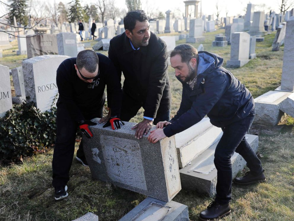 PHOTO: Three men help re-set a tombstone at the Jewish Mount Carmel Cemetery, Feb. 26, 2017, in Philadelphia.