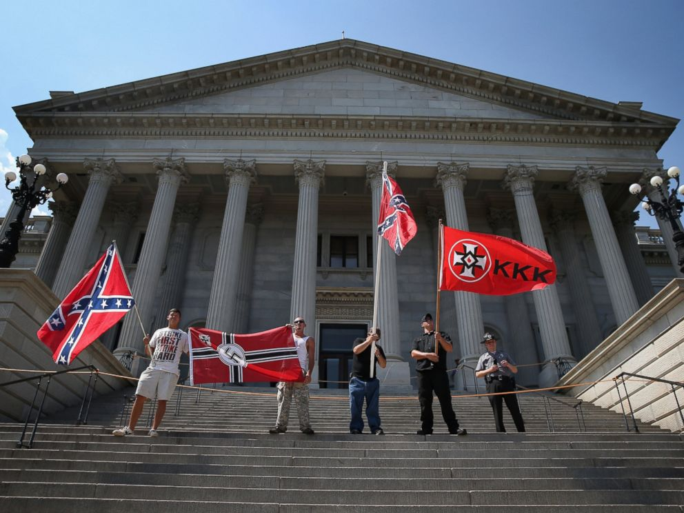 PHOTO: Ku Klux Klan members take part in a Klan demonstration at the state house building on July 18, 2015 in Columbia, South Carolina.