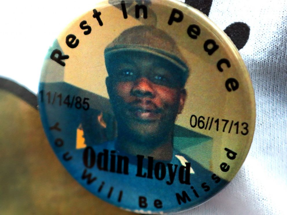 PHOTO: A funeral service was held for Odin Lloyd at the Holy Spirit Church in Mattapan. Lloyd was allegedly shot to death by former Patriots player Aaron Hernandez. A funeral-goer wears a button with his portrait.