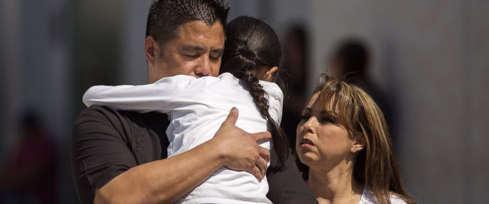 PHOTO: North Park Elementary School students and parents are reunited at Cajon High School after a shooting at their school on April 10, 2017 in San Bernardino, Calif.