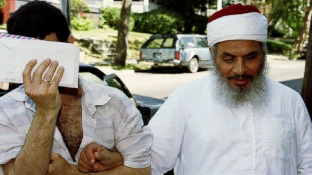 PHOTO: Sheik Omar Abdel-Rahman (R) entering his apartment building with an unidentified man (L) after afternoon prayers at his mosque in Jersey City, New Jersey, June 25, 1993.
