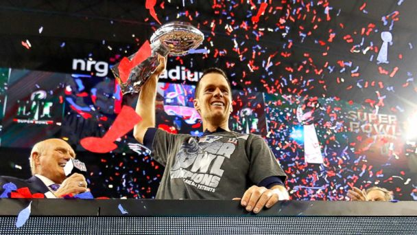 PHOTO: New England Patriots' quarterback Tom Brady celebrates with the Vince Lombardi Trophy after defeating the Atlanta Falcons during Super Bowl 51 at NRG Stadium  in Houston, February 5, 2017.