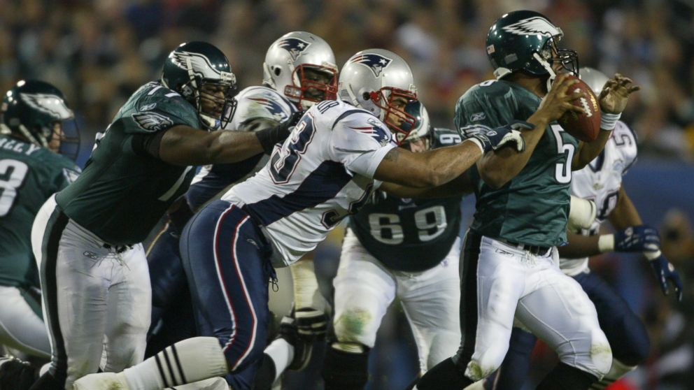 PHOTO: Philadelphia Eagles Donovan McNabb against New England Patriots Richard Seymour during Super Bowl in Jacksonville, Fla, on Feb.6, 2005 at ALLTEL Stadium.