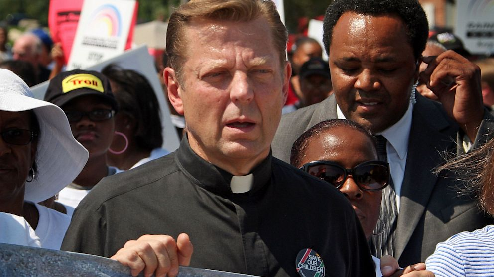 PHOTO: Father Michael Pfleger attends an anti-gun rally outside the manufacturing facilities of D. S. Arms in this August 28, 2007 file photo taken in Barrington, Illinois.