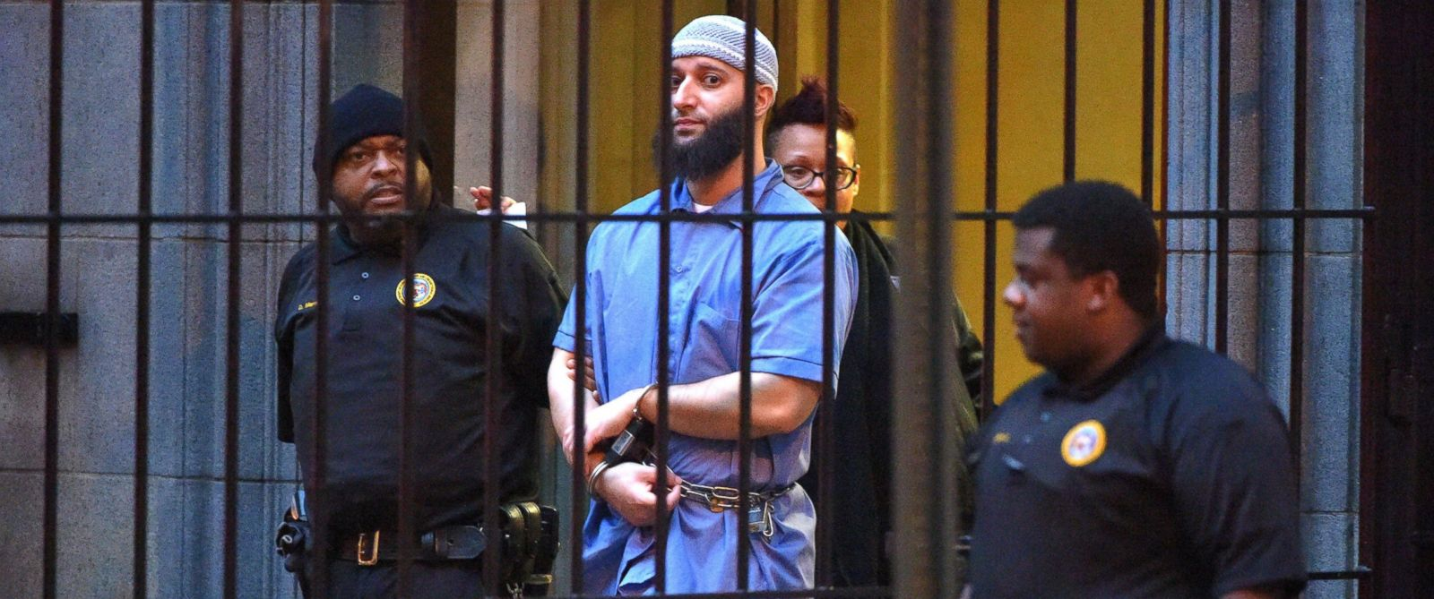 "PHOTO: Officials escort ""Serial"" podcast subject Adnan Syed from the courthouse following the completion of the first day of hearings for a retrial in Baltimore on Feb. 3, 2016."