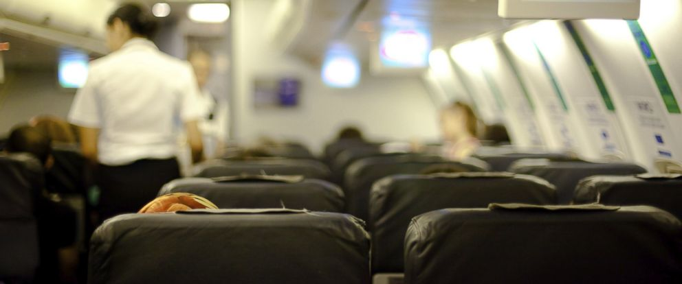 PHOTO: Airline passengers sit in their seats in an undated stock photo.