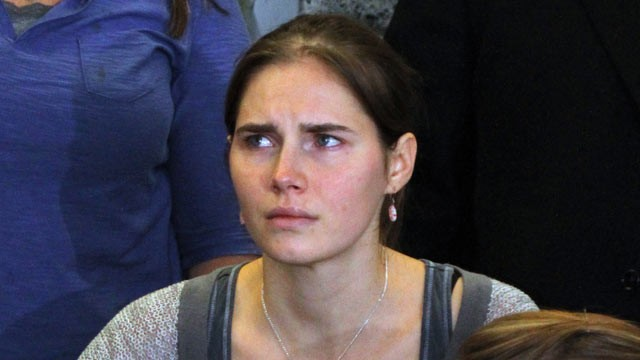 Amanda Knox is seen during a news conference shortly after her arrival at Seattle-Tacoma International Airport October 4, 2011, in Seattle