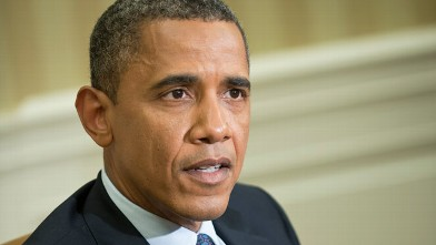 PHOTO: US President Barack Obama speaks to the press after a meeting with Filipino counterpart Benigno Aquino in the Oval Office of the White House on June 8, 2012 in Washington.