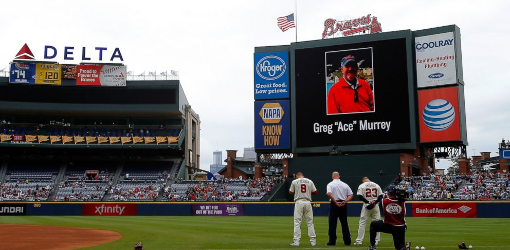 PHOTO: An American flag is lowered to half-staff in memory of Greg Ace Murrey who fell to his death at the game between the Atlanta Braves and the New York Yankees, Aug. 30, 2015 in Atlanta.