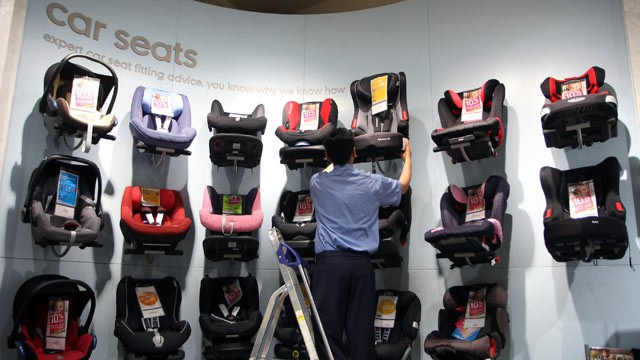 PHOTO: An employee removes a child's car seat from the display at a Mothercare Place store in London, May 12, 2011.