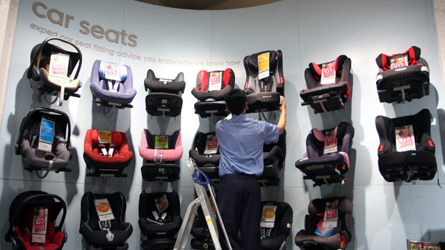 PHOTO: An employee removes a childs car seat from the display at a Mothercare Place store in London, May 12, 2011.