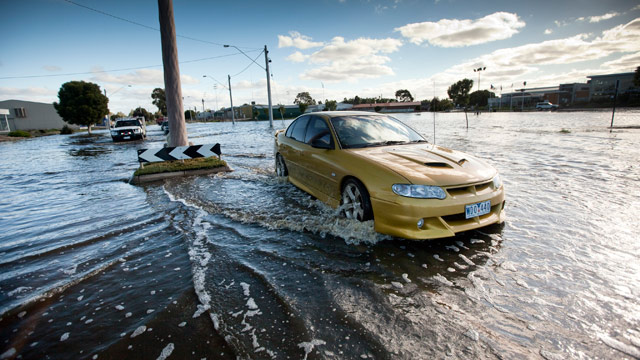 PHOTO: A car drives through flooded streets near the Wimmera River, on January 17, 2011 in Horsham, Australia.