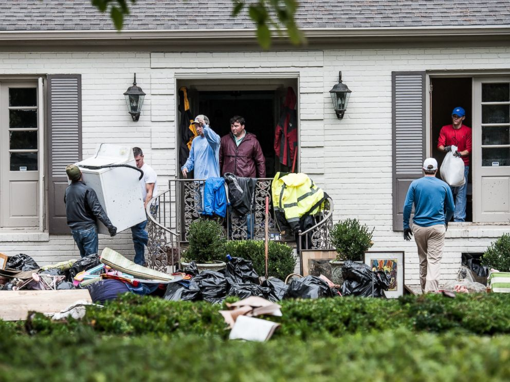PHOTO: Neighbors and friends help clean up a home affected by flood waters in the Forest Acres neighborhood, Oct. 5, 2015 in Columbia, S.C.