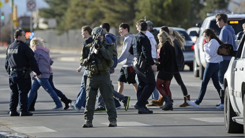 PHOTO: Students are escorted out of Arapahoe High School in Centennial, Colo., Dec. 13, 2013.